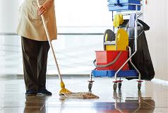 Housekeeper mopping