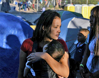 Honduran migrant mother and child